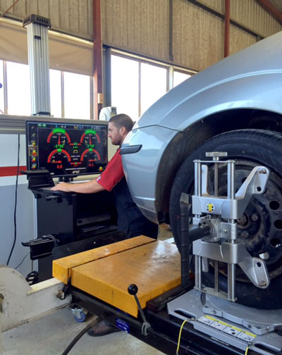 Rob-works-on-wheel-aligner-in-Yarram-Automotive-Centre